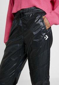 Converse - VOLTAGE JOGGERS - Trousers - black - 6