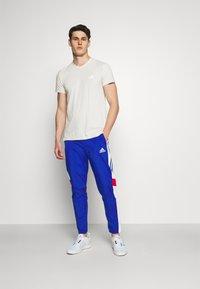 adidas Performance - TRACK - Träningsbyxor - team royal blue/white/scarlet - 1