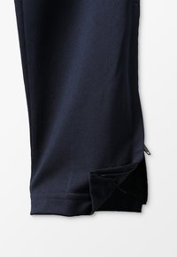 Nike Performance - DRY - Tracksuit bottoms - obsidian/white - 3