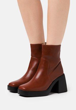 LEXUS - Platform ankle boots - cognac