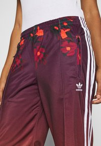 adidas Originals - GRAPHICS SPORTS INSPIRED PANTS - Tracksuit bottoms - multicolor - 3