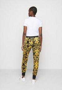 Versace Jeans Couture - Teplákové kalhoty - black - 0