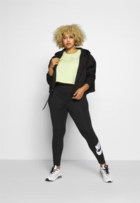 Nike Sportswear - LEGASEE PLUS - Leggings - black/white - 1
