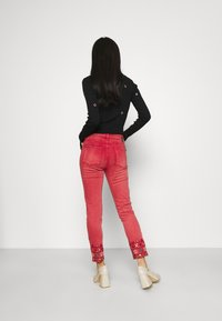Desigual - PANT DELFOS - Slim fit jeans - red - 2