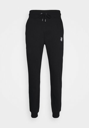 MUSCLE - Tracksuit bottoms - black