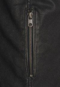 Tigha - CADAN - Leather jacket - black stone wash - 5
