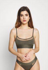 Calvin Klein Underwear - TONAL LOGO NEWNESS UNLINED BRALETTE - Topp - dark green - 0