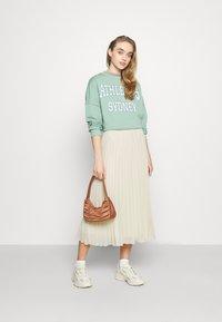 Monki - LAURA PLISSÉ SKIRT - A-line skirt - beige - 1