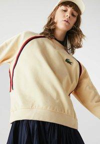 Lacoste - Sweatshirt - beige - 1