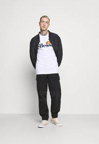 Ellesse - SMALL LOGO PRADO - Print T-shirt - white - 1