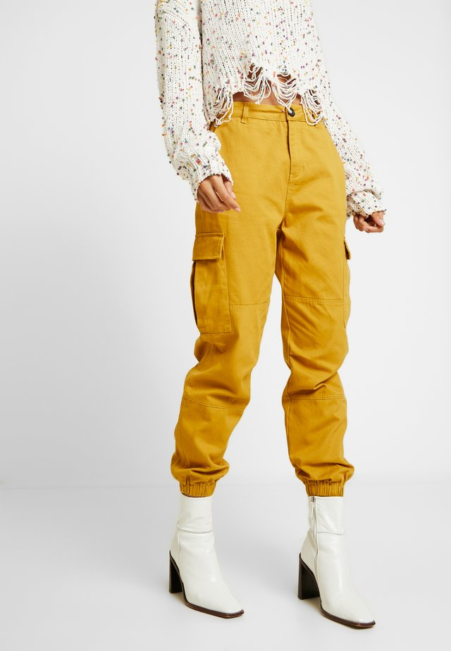 JOGGER PANTS WITH - Trousers - mustard