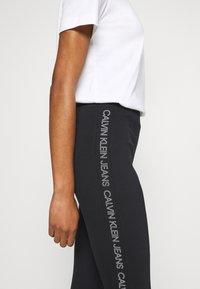Calvin Klein Jeans - MOTO OUTLINE LOGO MILANO - Legging - black - 4