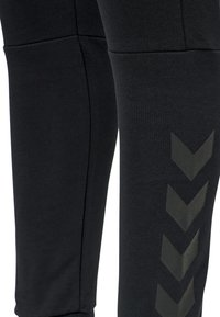 Hummel - Tracksuit bottoms - black - 4