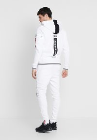 Alpha Industries - Tracksuit bottoms - white - 2