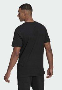 adidas Performance - MOUNTAIN TEE M - Print T-shirt - black - 1