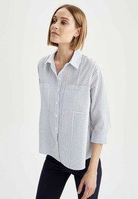 DeFacto - OVERSIZED  - Button-down blouse - blue - 0