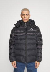 Jordan - JUMPMAN AIR PUFFER - Winter jacket - black/white - 1