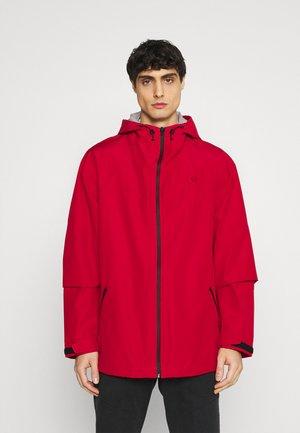 ALL TERRAIN GEAR RAIN JACKET - Waterproof jacket - red