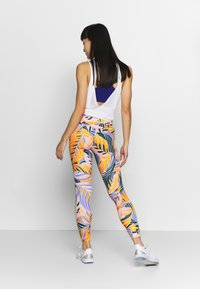 Nike Performance - 7/8 PSYCH  - Leggings - light thistle/white - 2