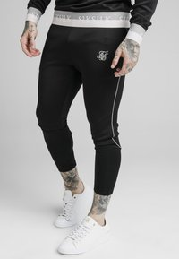SIKSILK - DELUXE AGILITY JOGGER - Tracksuit bottoms - black - 0