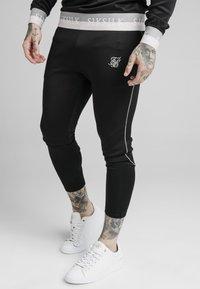 SIKSILK - DELUXE AGILITY JOGGER - Pantalones deportivos - black - 0