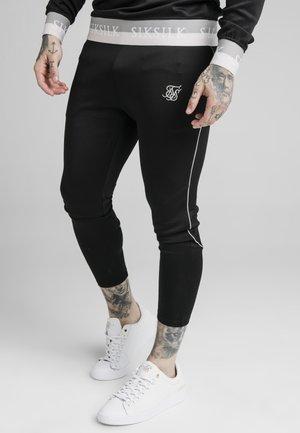 DELUXE AGILITY JOGGER - Pantalon de survêtement - black