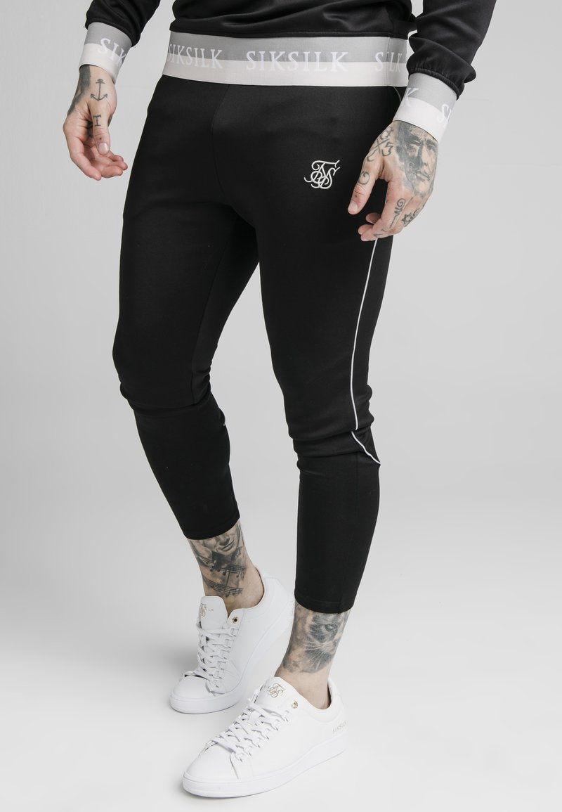 SIKSILK - DELUXE AGILITY JOGGER - Tracksuit bottoms - black