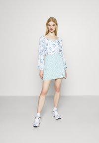 Hollister Co. - SOFT SLIT - Mini skirt - light blue - 1