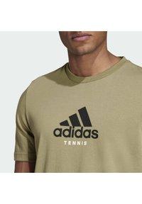 adidas Performance - US OPEN FENC - Sports shirt - green - 4