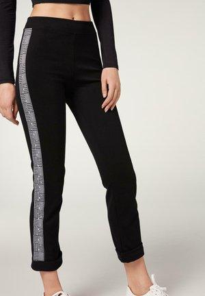 MIT EINSATZ - Leggings - Trousers - nero