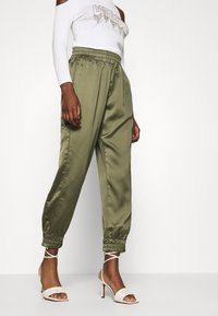 Guess - EUPHEMIA - Tracksuit bottoms - greek olive - 3