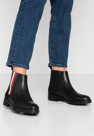 SPORTY MONOGRAM FLAT - Ankle boots - black