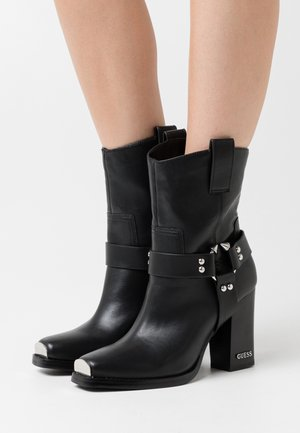 FLAVIA - High heeled ankle boots - black