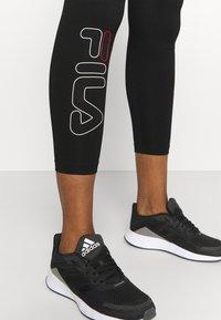 Fila - FELIZE 7/8 LEGGINGS - Leggings - black - 3