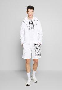 EA7 Emporio Armani - Print T-shirt - white - 1
