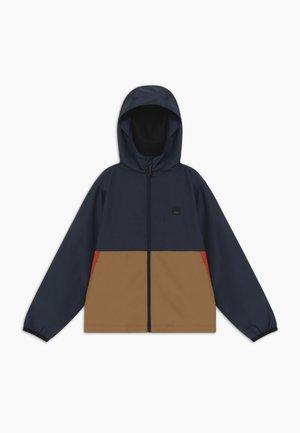 TRANSPORT WINDBREAKE - Waterproof jacket - dark indigo