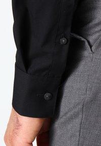 Calvin Klein Tailored - BARI SLIM FIT - Formal shirt - black - 4