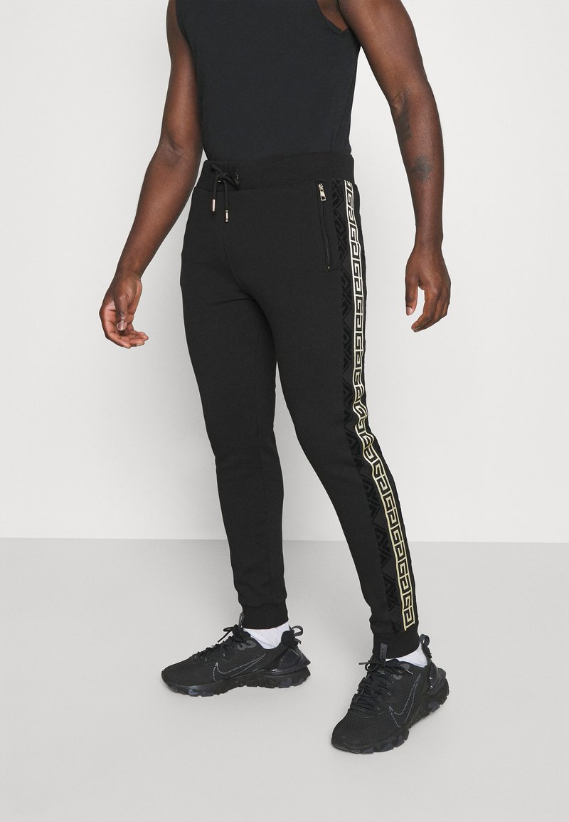 Glorious Gangsta - BARCO - Tracksuit bottoms - black/gold