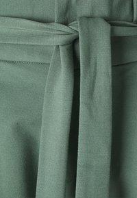 Vero Moda Tall - VMEVA PAPERBAG PANT - Trousers - laurel wreath - 2