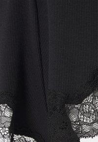Hunkemöller - x NA-KD SHORT MIA - Pyjama bottoms - caviar - 2