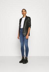 Calvin Klein - HIGH RISE - Jeans Skinny Fit - dark blue - 1