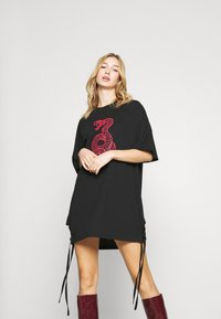 Milk it - DRESS WITH LACE UP SIDES & SNAKESCREEN - Day dress - black - 0