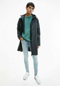 Calvin Klein Jeans - TECHNICAL RAINCOAT - Parka - ck black - 1