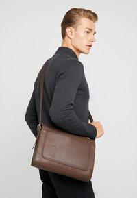 Pier One - LEATHER - Across body bag - dark brown - 1