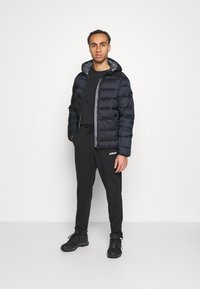 Champion - HOODED JACKET - Winter jacket - black - 1