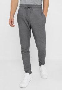 Nike Sportswear - OPTIC - Tracksuit bottoms - dark grey/heather - 0