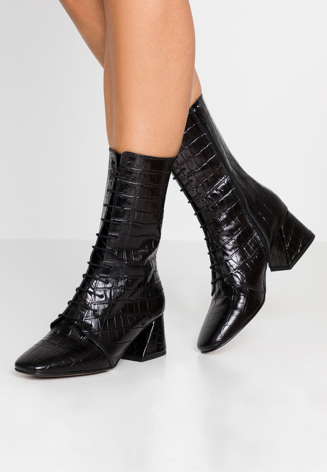 Stivali con i lacci - monterrey