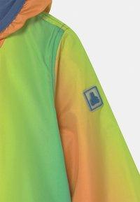 GAP - WINDBREAKER - Light jacket - mango - 2