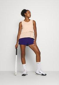 Nike Performance - DRY - Funkční triko - guava ice/black - 1