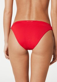Calzedonia - MIT UNSICHTBAREN NÄHTEN INDONESIA - Bikini bottoms - hawaiian red - 1